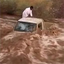Truck Drives in to Raging Flood