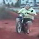 Fat guy on a little bike.