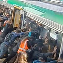 Passengers Push Train to Free Trapped Man